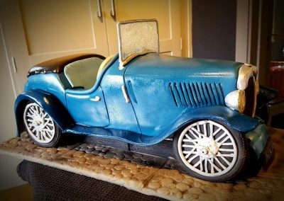 1930's MG. Faithful copy of a vintage car in chocolate sponge and fondant... To sit on larger base cake... Total price £350