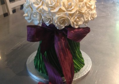 Bouquet Cake £495. Beautiful Vanilla sponge cake decorated with 65-70 hand-made sugar roses
