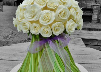 White roses bouquet £495 Soft vanilla sponge and buttercream filling with fondant roses
