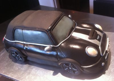 Mini Cooper Cabriolet £265. Chocolate sponge cake with dark chocolate buttercream, covered with fondant icing.
