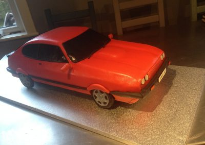 1986 Ford Capri  £485 Huge chocolate and hazelnut sponge covered with hazelnut chocolate ganache and fondant