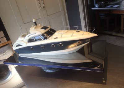 Sunseeker Predator boat/yacht cake Chocolate sponge boat covered with fondant and built on a mirror polished steel base. £394