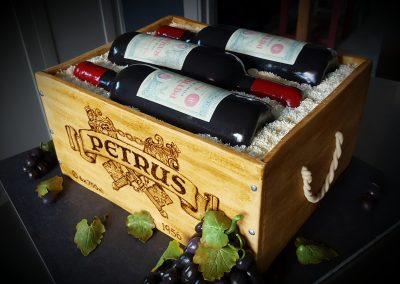 Wine Case Cake...Lifesize. Completely edible including the personalised wine labels. Dark chocolate and hazelnut sponge cake covered with fondant. White chocolate sawdust. £495