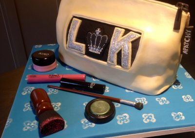 Make-up Bag and accessories.Vanilla sponge make-up bag covered with fondant. Fondant make-up pots and brushes. £240