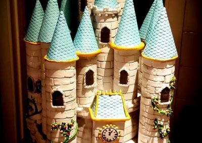 Fairy castle £350. Lemon sponge with fondant and lots of icing detail