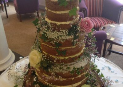 'Naked Wedding Cake' £525. Soft sponge layers of Vanilla, Pistachio and coffee decorated with bridal flowers