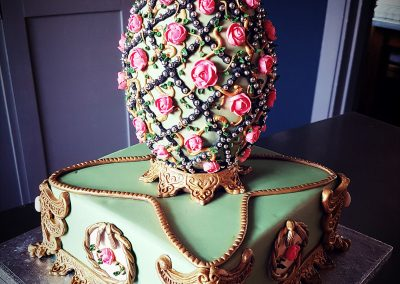 Faberge Egg Cake. Elegant vanilla sponge cake decorated with fondant and topped with a tinted white chocolate egg, highly decorated. £240