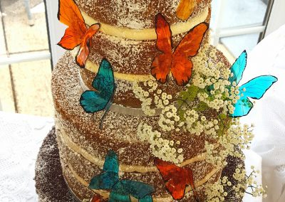 'Naked Wedding Cake' £595. Super-soft tiers in vanilla, coffee and chocolate sponge with gelatin butterflies in the wedding theme colours