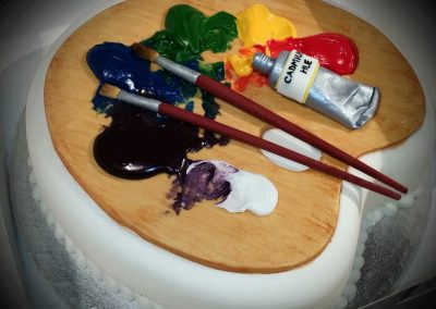 Artist's cake. Deep sponge topped with an artist's palette, brushes and paint all created in sugarpaste. £185