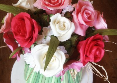 Bouquet Cake-small £385. Multi coloured bouquet of sugarpaste flowers on Vanilla sponge cake.