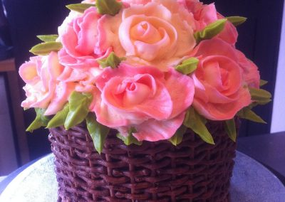 Buttercream Rose Basket £250. Chocolate sponge cake iced entirely in buttercream to represent a basket of roses.