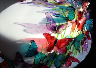 Butterfly Cake £185. Beautiful light Victoria sponge cake. White fondant icing hand painted with lavender flowers, and transparent gelatine butterflies