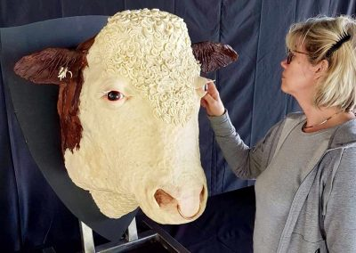 A photo of a cake of a cow realistic