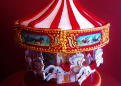 Carousel Cake Chocolate sponge cake carousel with royal icing horses and detail.