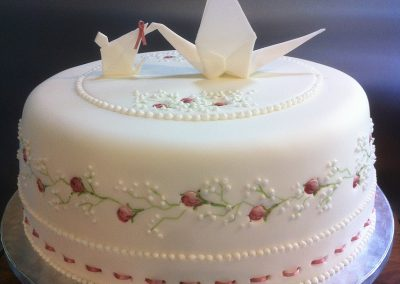 Christening Cake £185. Beautiful semi-formal cake for a christening. 'Origami Stork' in sugar paste to match the client's invitations.