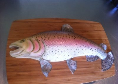 Trout Cake £185. Light Vanilla sponge with vanilla buttercream, covered in fondant and hand painted.
