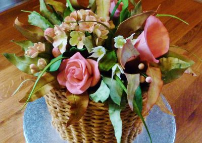 Flower Basket £365. Beautiful selection of sugarpaste flowers and foliage in a coffee cake 'basket'