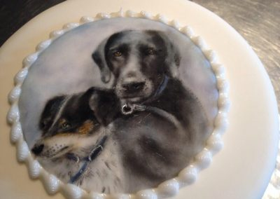 Pet portrait cake £235. Sponge cake with a handpainted picture in edible colour dust